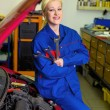 Woman as a mechanic in auto repair shop — Stock Photo #66012591