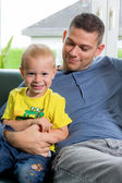 Cheerful boy and father — Stock Photo