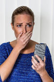 Woman is shocked by sms — Stock Photo