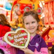 Child with gingerbread heart. mothers day — Stock Photo #66255253