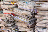 Stack of waste paper. old newspapers — Stockfoto