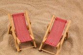 Deck chair on the sandy beach — Stock Photo