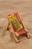 Beach chair with euro bill — Stock Photo