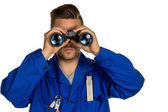 Craftsman with binoculars — Stock Photo