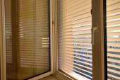 Blinds for sun protection on windows — Stock Photo