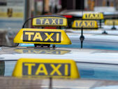 Taxis at a taxi rank — Stock Photo