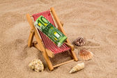 Beach chair with euro bill — Stock Photo