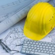 House plan with a construction worker helmet — Stock Photo #70311643