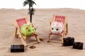 Piggy bank in a deck chair — Stock Photo