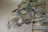 Broken bike in the bike racks, — Stockfoto