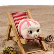 Beach chair with piggy bank — Stock Photo #70499525