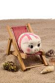 Beach chair with piggy bank — Stock Photo