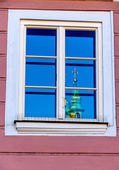 Church tower reflected in a window — Stock Photo