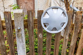 Old fence and aluminum rim — Stock Photo