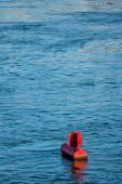 Red buoy water surface — Zdjęcie stockowe