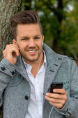 Man listens to music on mobile phone — Stock Photo