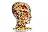 Head made of glass with tablets — Stock Photo