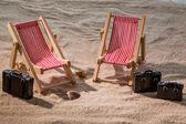 Deckchair on a sandy beach — Stock Photo