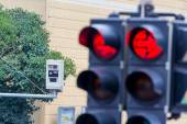 Traffic light with red light camera — Stock Photo