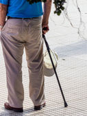 Tourist with cap and cane — Stock Photo