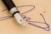 Signature and a fountain pen — Stock Photo