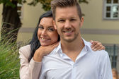 Loving couple in a park — Stock Photo