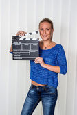 Woman with clapperboard — Stock Photo