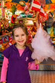 Child on kirtag with cotton candy — Stock Photo