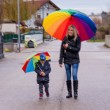 Mother and child with umbrella — Stock Photo #73484961