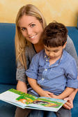 Mother and son with a book — Stock Photo