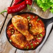 Baked chicken legs with tomato sauce — Stock Photo #56842549