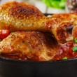 Baked chicken legs with tomato sauce — Stock Photo #56842551