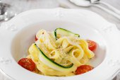 Pasta with zucchini tomatoes and parmesan cheese — Foto de Stock