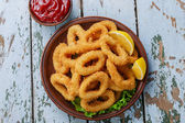 Fried squid rings breaded with lemon — Stock Photo