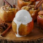 Baked apples with raisins and cinnamon ice cream — Stock Photo #60756411