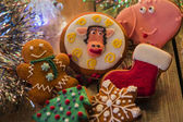 Christmas gingerbread on a wooden surface — Stock Photo