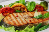 Steak grilled salmon with vegetables on a plate — Foto de Stock