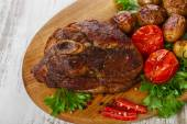 Roasted pork shoulder on the bone with potatoes — Stock Photo
