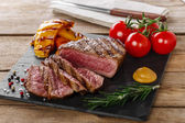 Grilled beef steak rare sliced with vegetables — Stock Photo