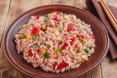 Rice with tomato corn and green peas — Stock Photo