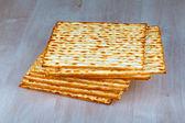 Matzah on wooden table — Stock Photo