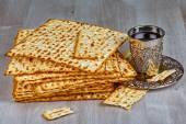 Matzah with kiddush cup of wine — Stock Photo