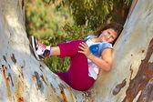Girl posing on a tree  — Stock Photo