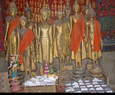 Gold figures of monks in Luang Prabang — Stock Photo