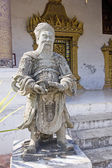Stone Guardian at buddist temple in Luang Prabang  — Stock Photo