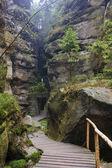 The narrow path among high rocks — Stock Photo