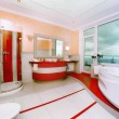 Luxury bathroom in red color — Stock Photo #66917903