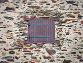 Window  in   stone wall — Stock Photo