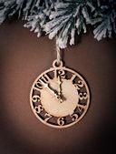Clock on fir tree branch — Stock Photo