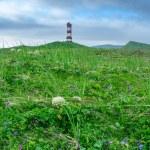 Lighthouse against blue cloudy sky — Stock Photo #75655313